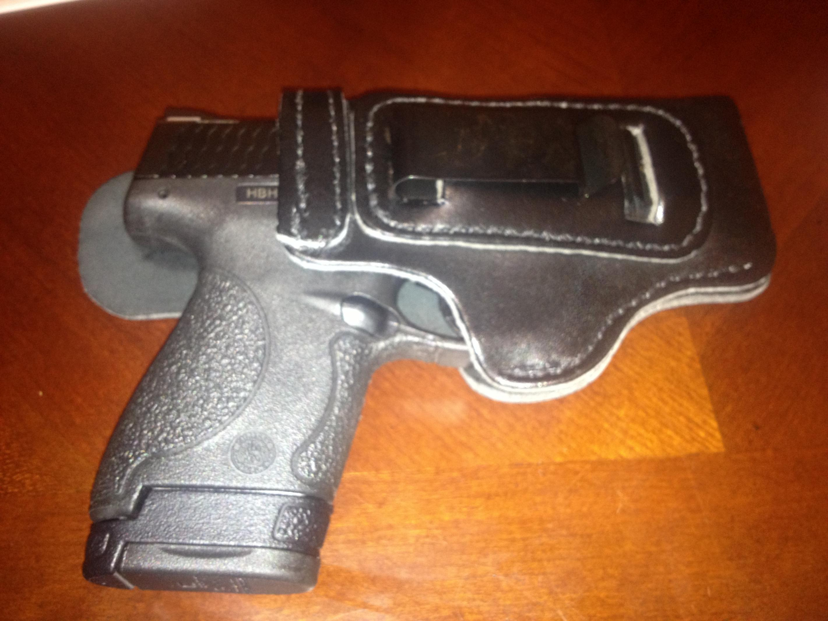 Just got my new holster for my new Shield.  Carry tomorrow!-001.jpg