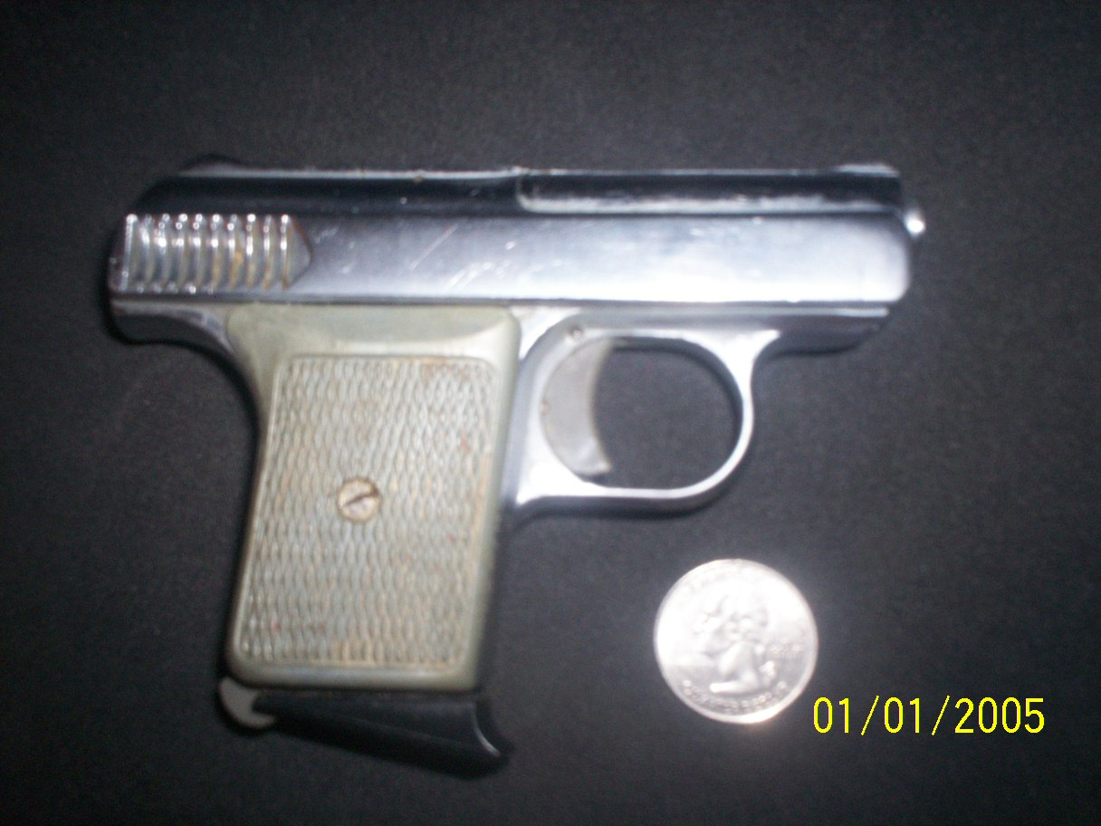 Know Anything About this old model pistol?-100_0460.jpg