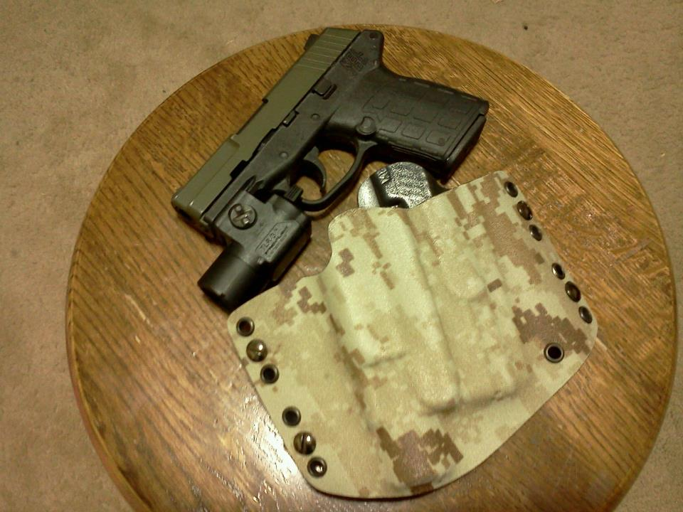 Carrying the G34 with SureFire X300 in a modified DSG Arms Alpha holster...-14215_512557515440088_1869746333_n.jpg