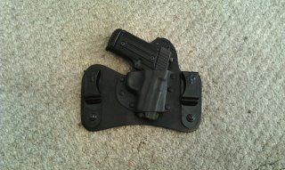 Finally found a good holster for my P238-554620_3630066323573_1631555996_2837944_195401632_n.jpg