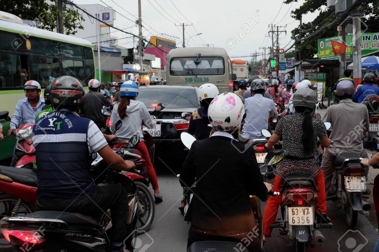 The Pedal Pushers (AKA-Bike Cyclists) are back in force-61913435-ho-chi-minh-city-viet-nam-aug-24-crowded-scene-asian-city-rush-hour-group-traf.jpg
