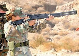 Name:  Benelli M4 female shooter.jpg