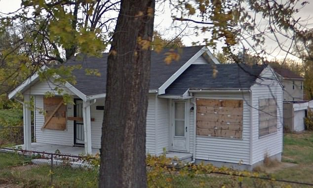 Ohio homeowner shoots dead two 17-year-old boys-boarded-house.jpg