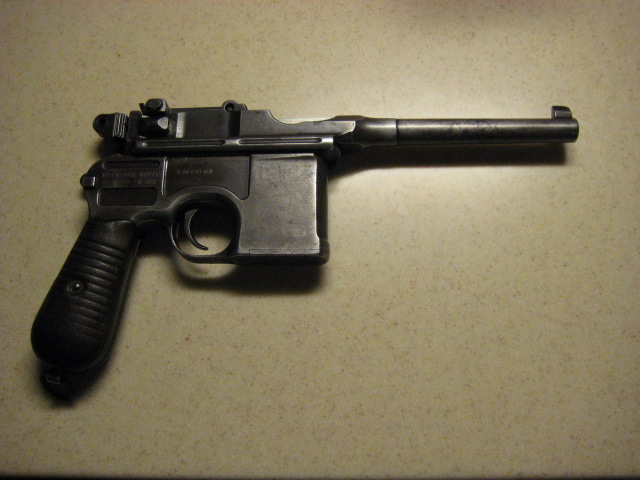 Bought an old CLIP fed pistol today.-broomhandle_r.jpg