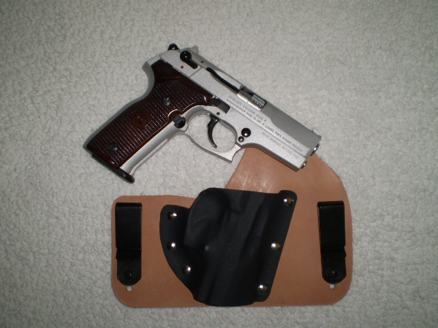 Looking for High Capacity 9mm, NO Glocks, what do you shoot and carry?-cougarwithholster.jpg