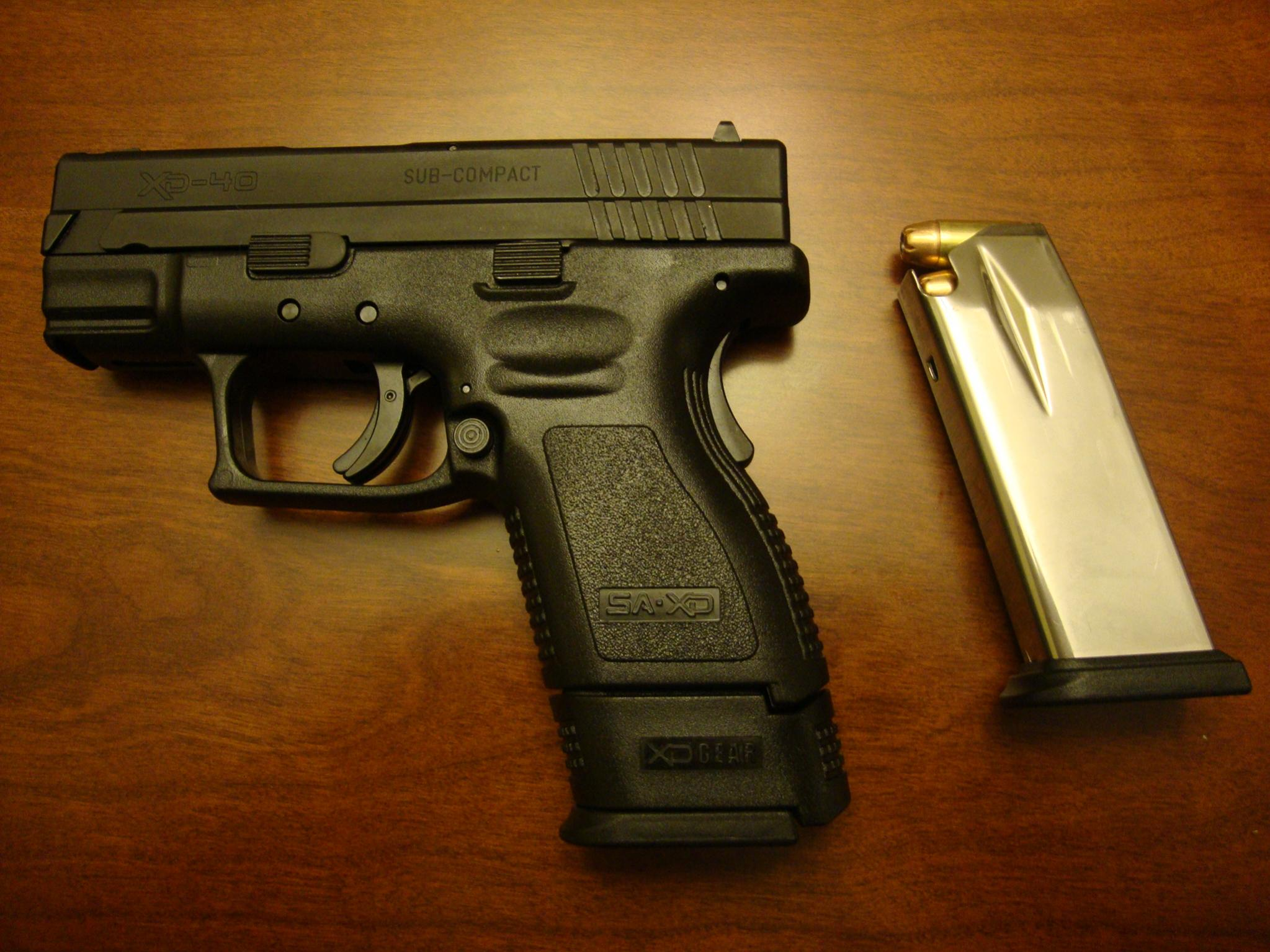 Do you/would you carry a gun in .40?-dsc00638.jpg