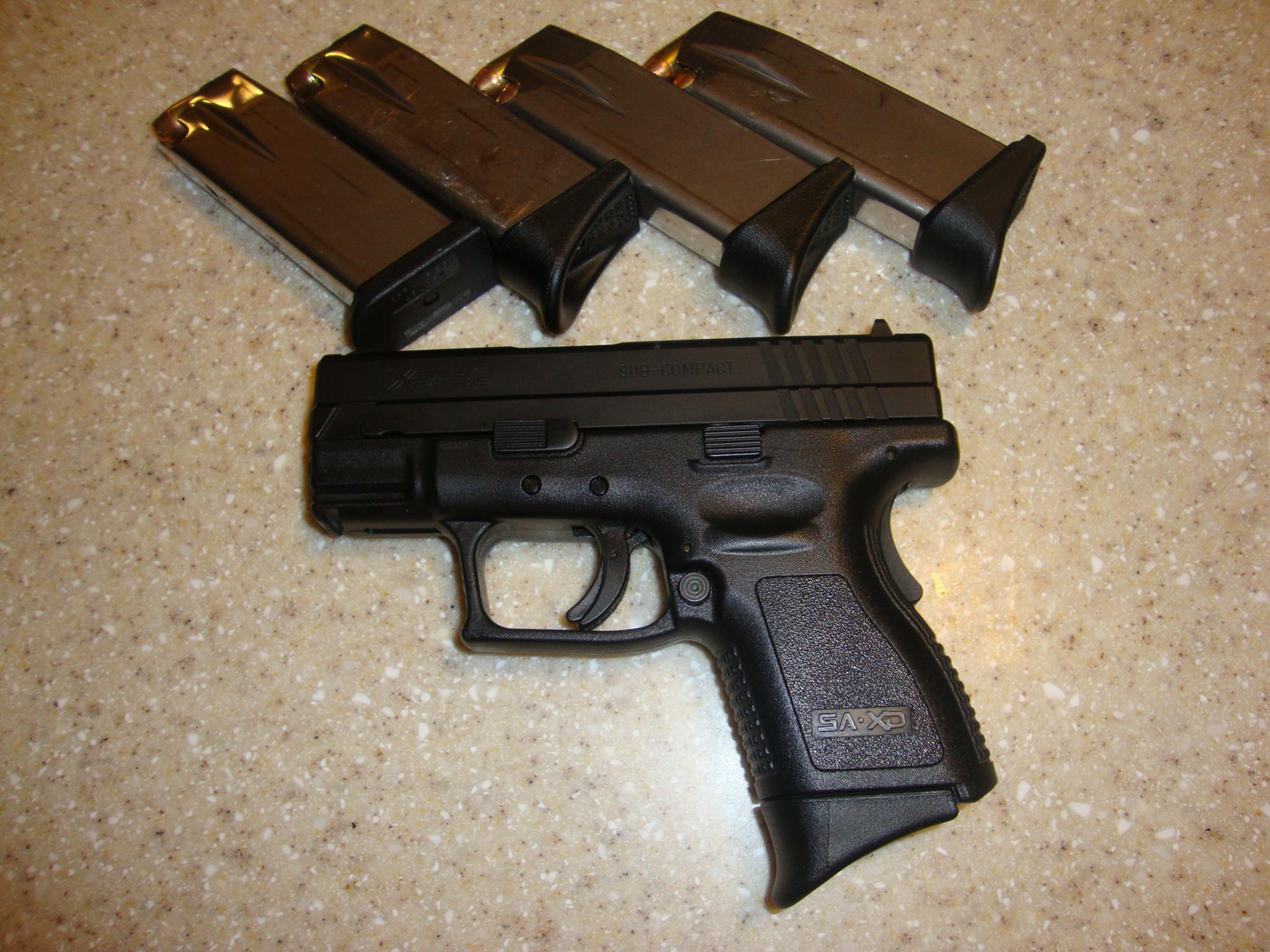 Do you/would you carry a gun in .40?-dsc02331.jpg
