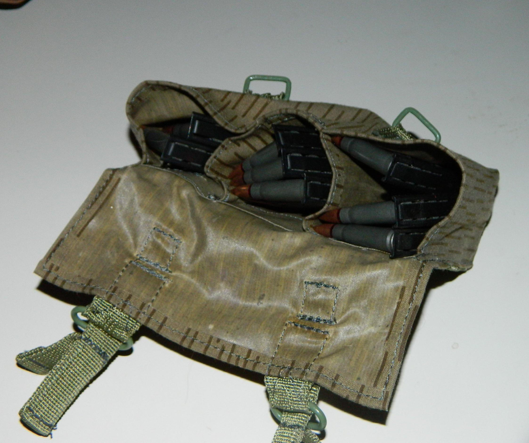How to hold spare ammo on a Marlin 1894C-e-german-ammo-pouch.jpg