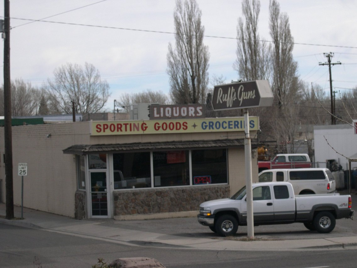 When you're a small town gun store you have to diversify ... picture of his sign.-flagstaff-commerce.jpg