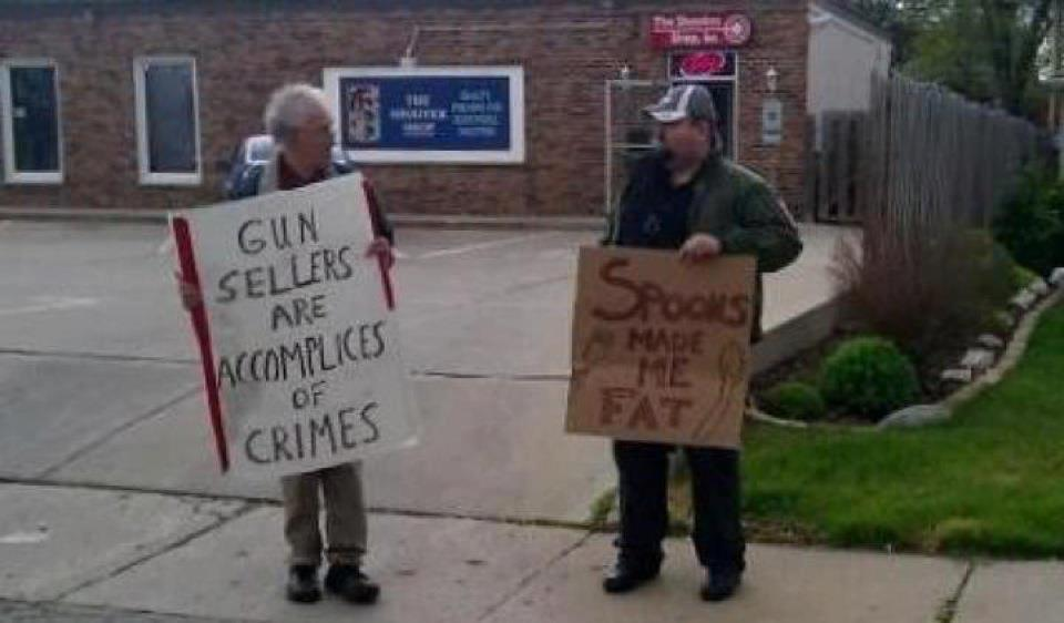 NEVER leave home without it! :)-funny-anti-gun-signs.jpg