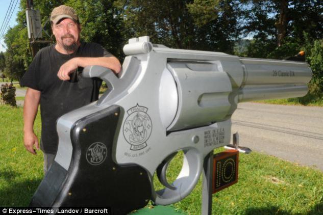 Putting gun yard signs to shame-gunmailbox.jpg