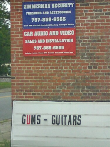 When you're a small town gun store you have to diversify ... picture of his sign.-guns-guitars.jpg