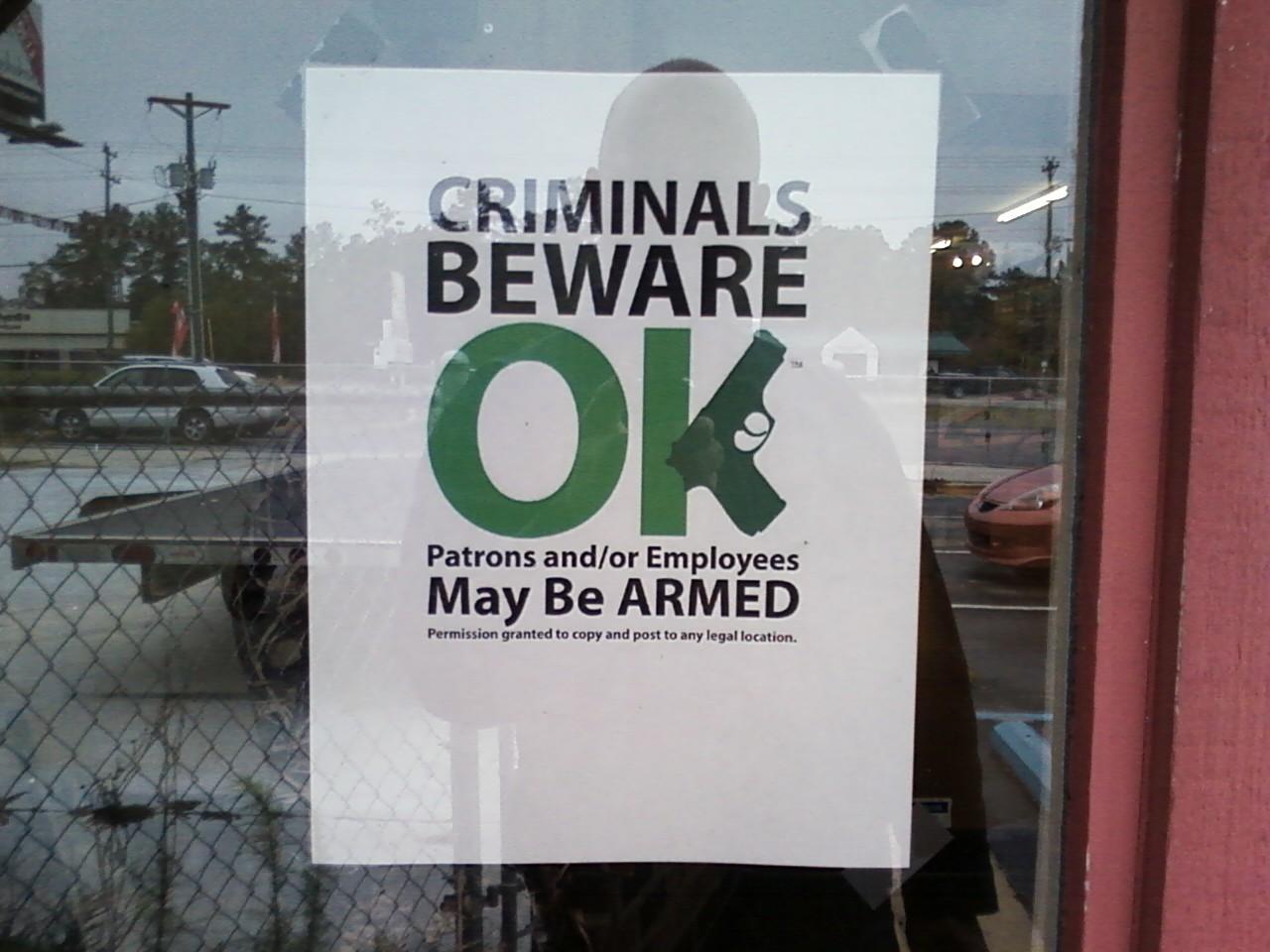 Sign in local gun shop window-gunshop-sign.jpg
