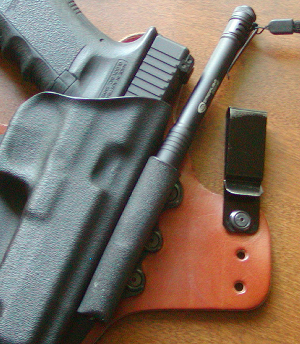 Carrying the G34 with SureFire X300 in a modified DSG Arms Alpha holster...-holsterlight.jpg