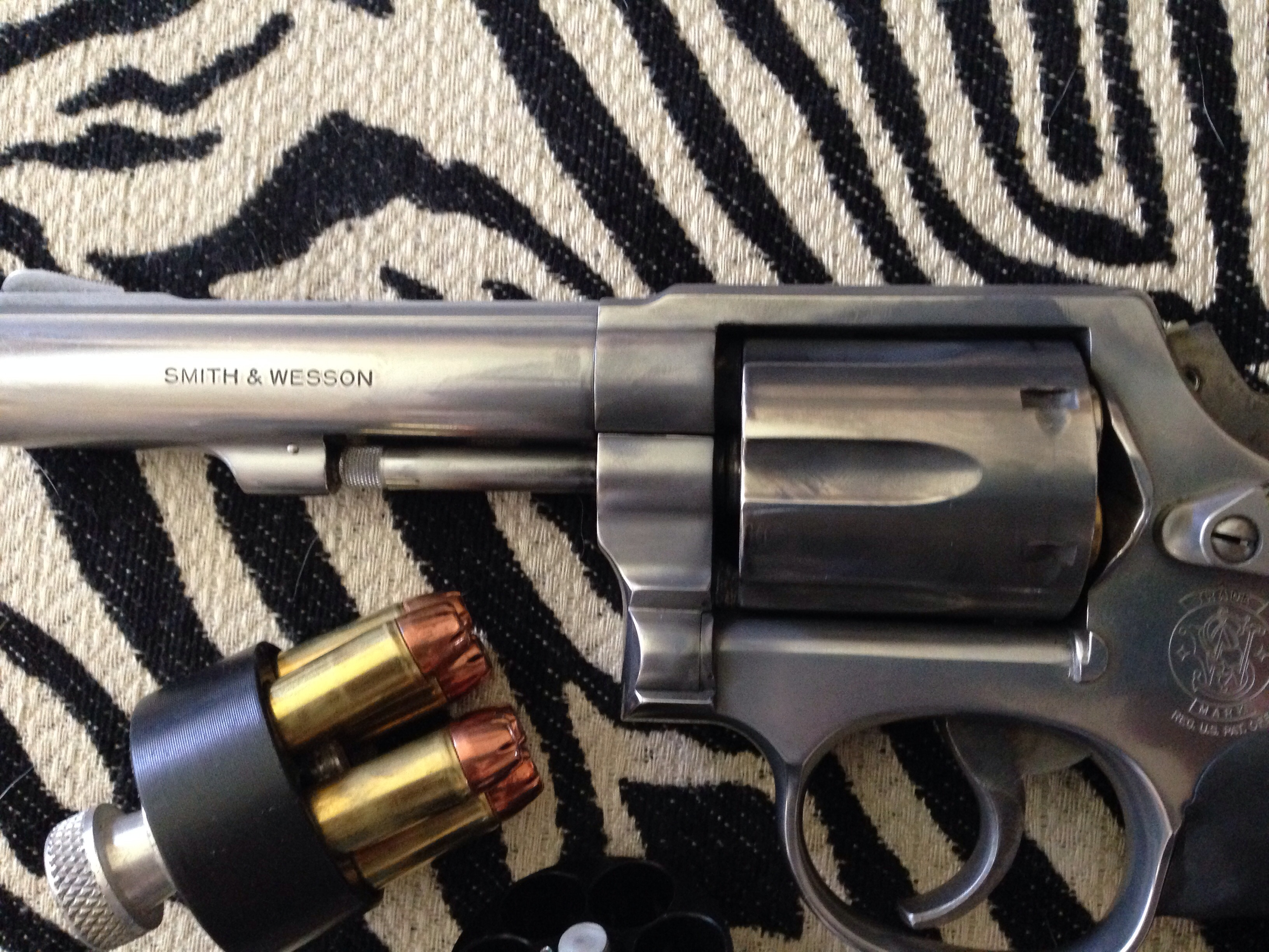 Wouldn't give a plugged nickel for a S&W revolver-image.jpg