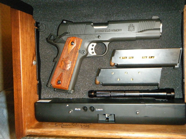 What do you keep your carry in next to your bed?-image00001.jpg