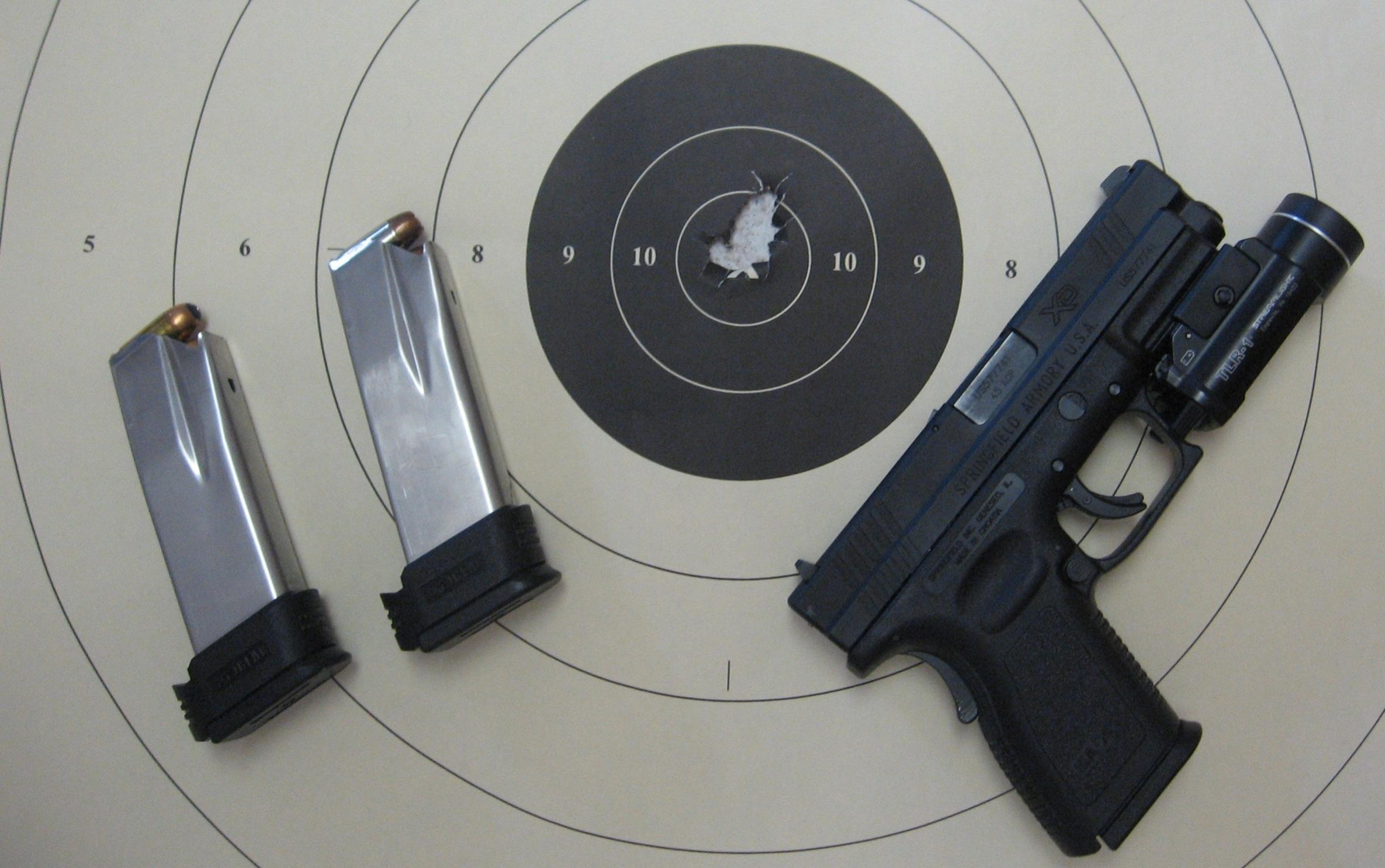 What is the most accurate handgun you have ever fired, fifteen yards and under?-img_0439.jpg