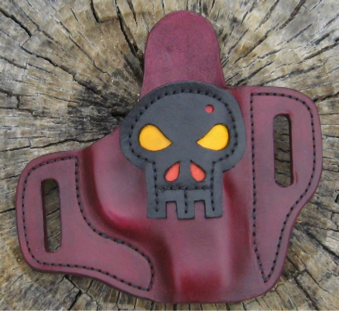 Ok, it's a little silly, but..... Zombie holster!-lc9skullowb.jpg