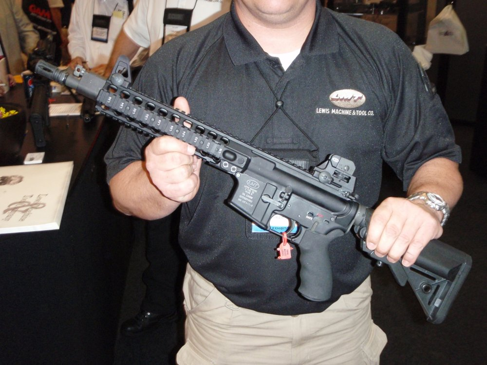 Already got the itch to buy another AR...-lmt_mrp_gas_piston_shot_show_2009_1.jpg