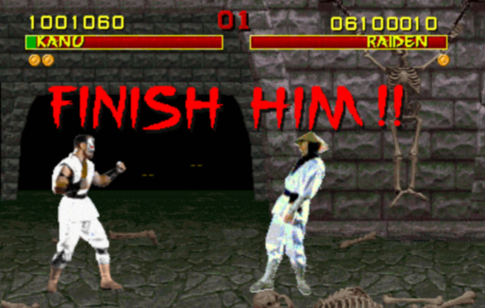 Guys disarms and shoots the hell out of another guy with his own gun-mortal_kombat_finish_him.png