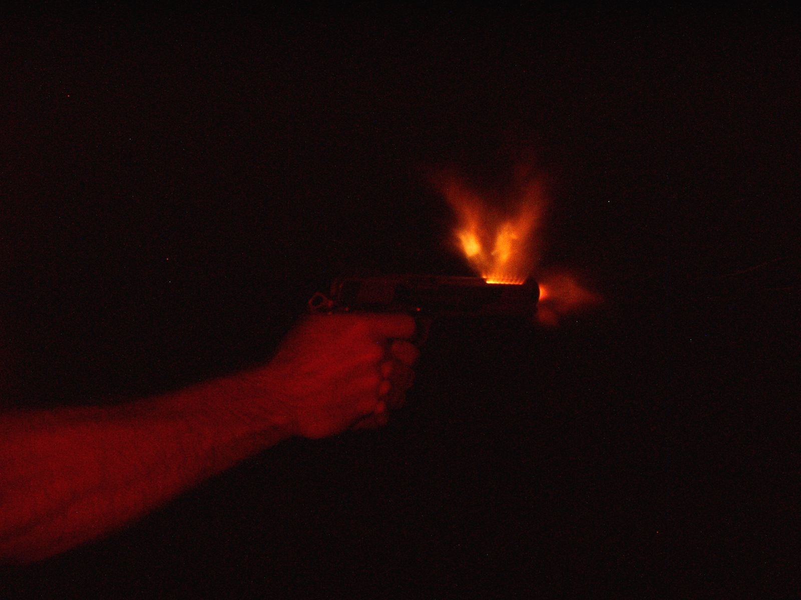 nighttime photo of ported 1911-night-longslide-lighter.jpg