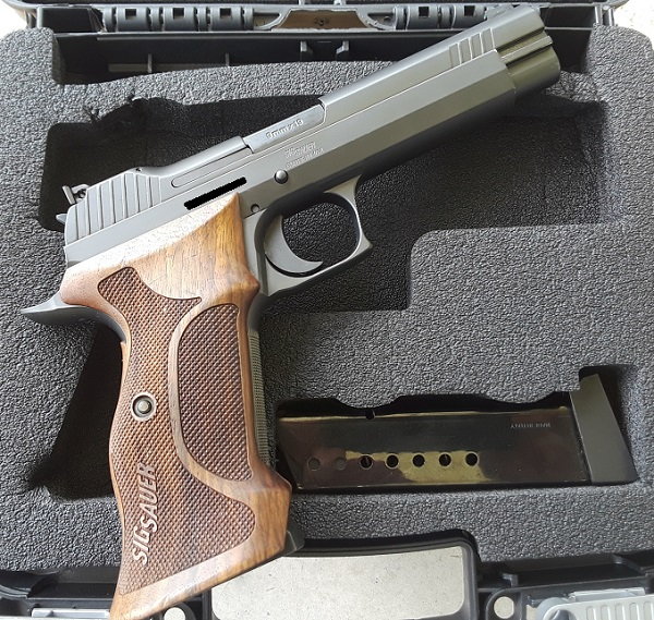 Anybody get anything good that's firearm related today?-p210_r2.jpg