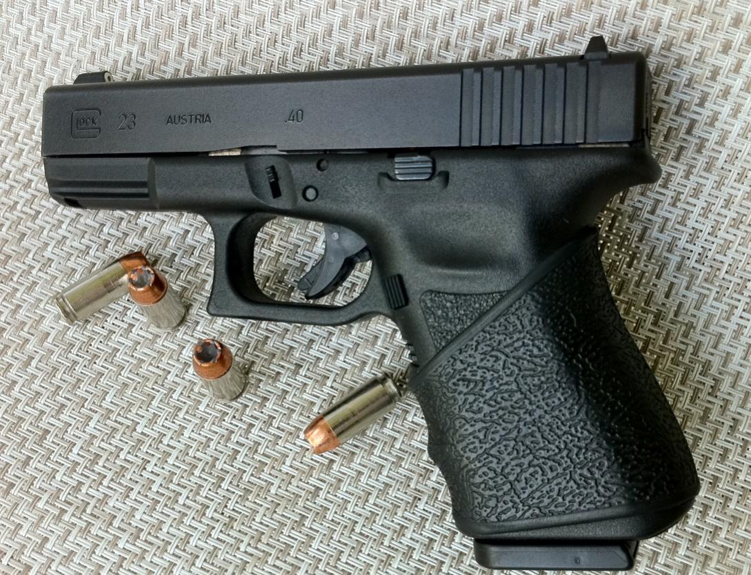 I got a hogue slip on grip for my glock 23-photo.jpg