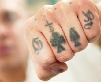 If you saw these tattoos how would you react?-punch.jpg