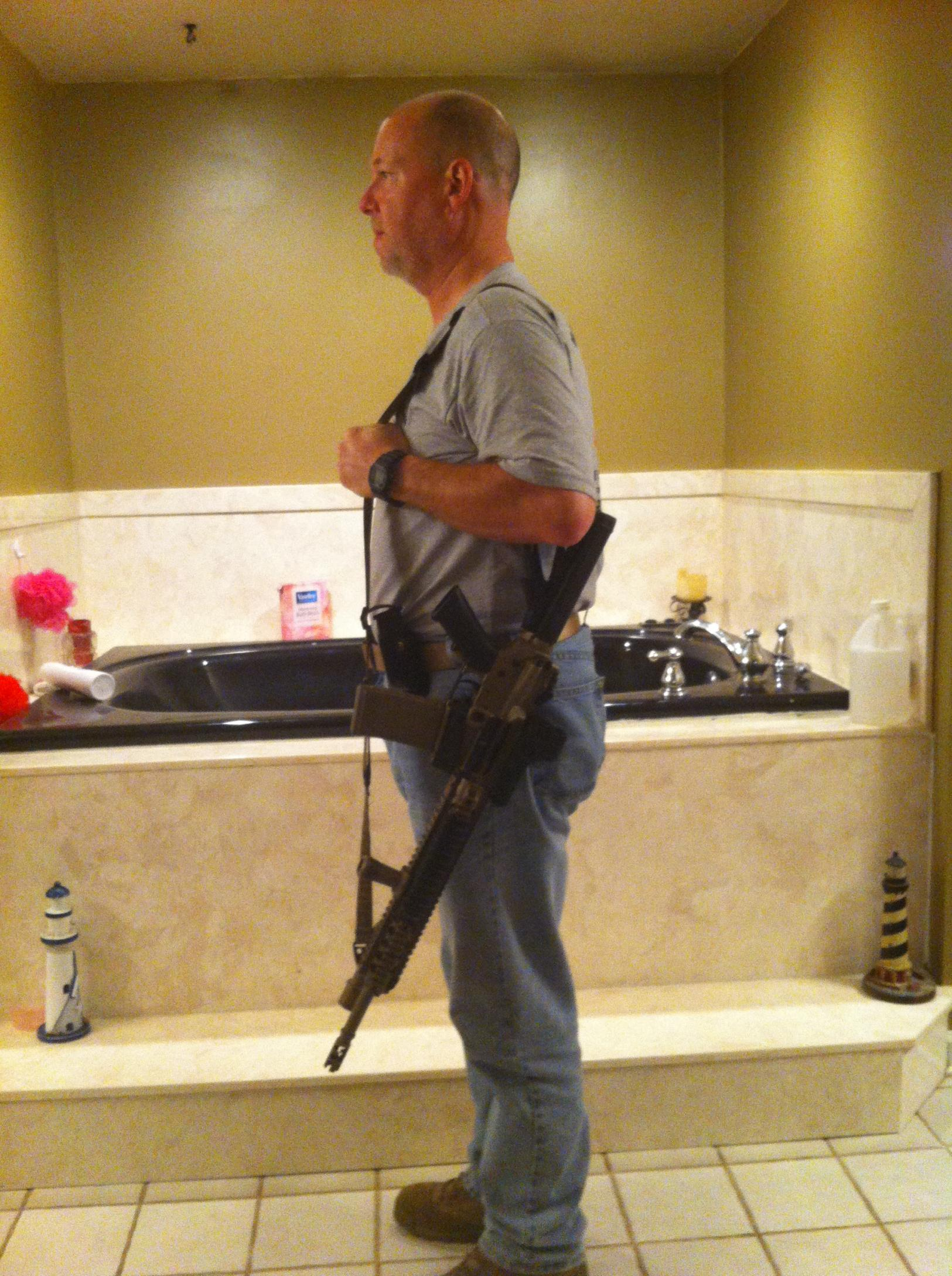 Defensive carry method, when carrying openly -- sidearms, long guns-rifle-slung-001.jpg
