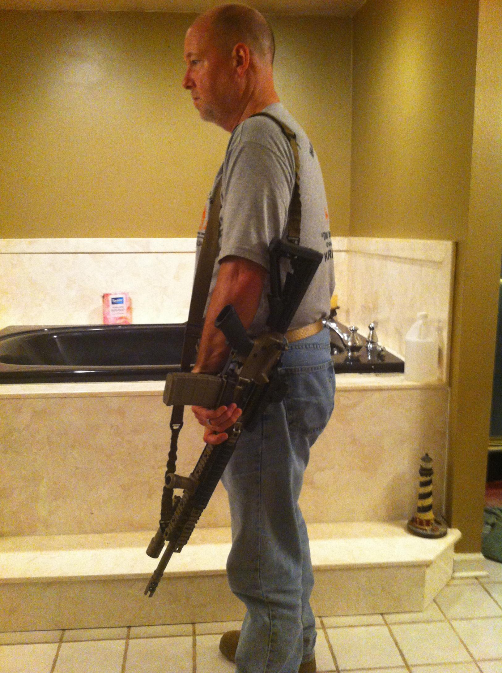 Defensive carry method, when carrying openly -- sidearms, long guns-rifle-slung-002.jpg