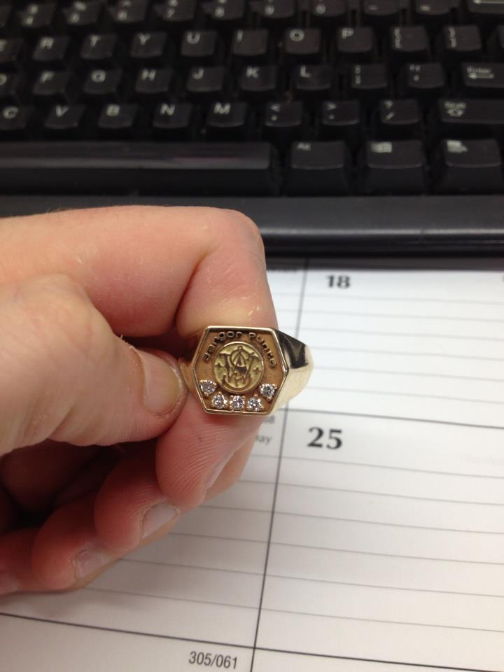 Want to see a cool piece of Smith and Wesson memoribilia?-s-w-ring.jpg
