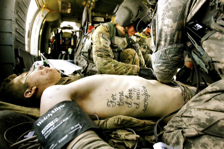 "Followup - Soldier in photo with ""sacrifice"" tattoo in medevac-sacrifice.jpg"
