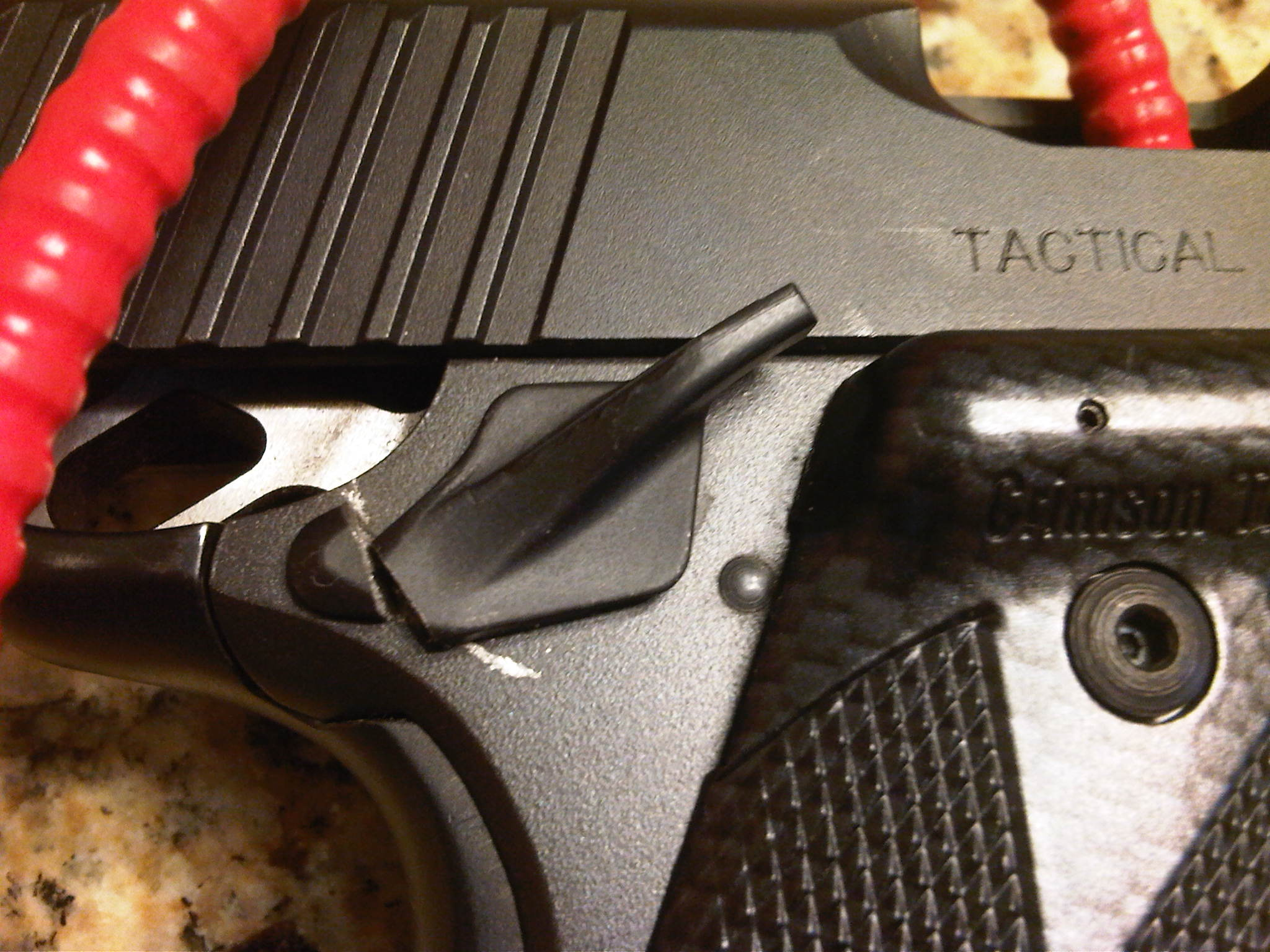 Broken Kimber right side bobbed safety-safety-broken.jpg