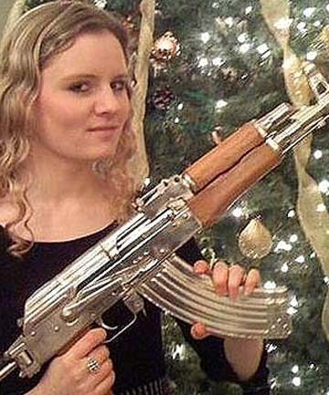 UK spy chief 'embarrassed' over pic of daughter with an AK on FB-sawers.jpg