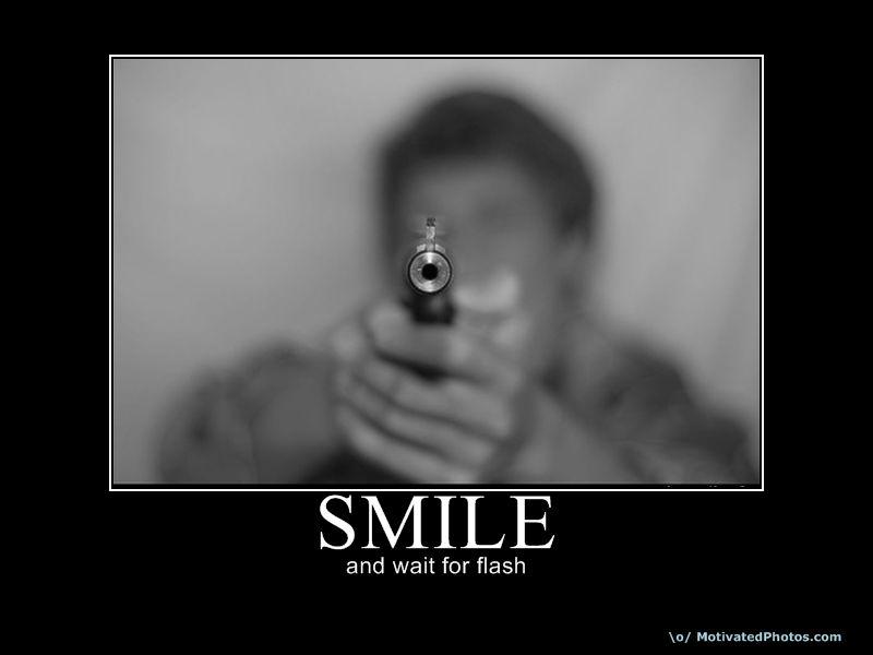Robber shoots bank customer......-smile.jpg