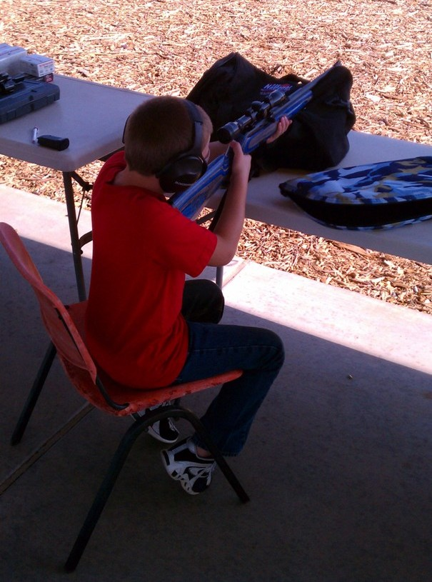 our new Remington 597 range report-son-trying-597.jpg