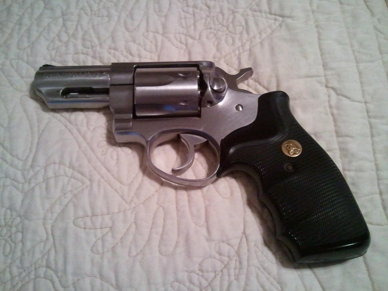 Image result for gun in bed
