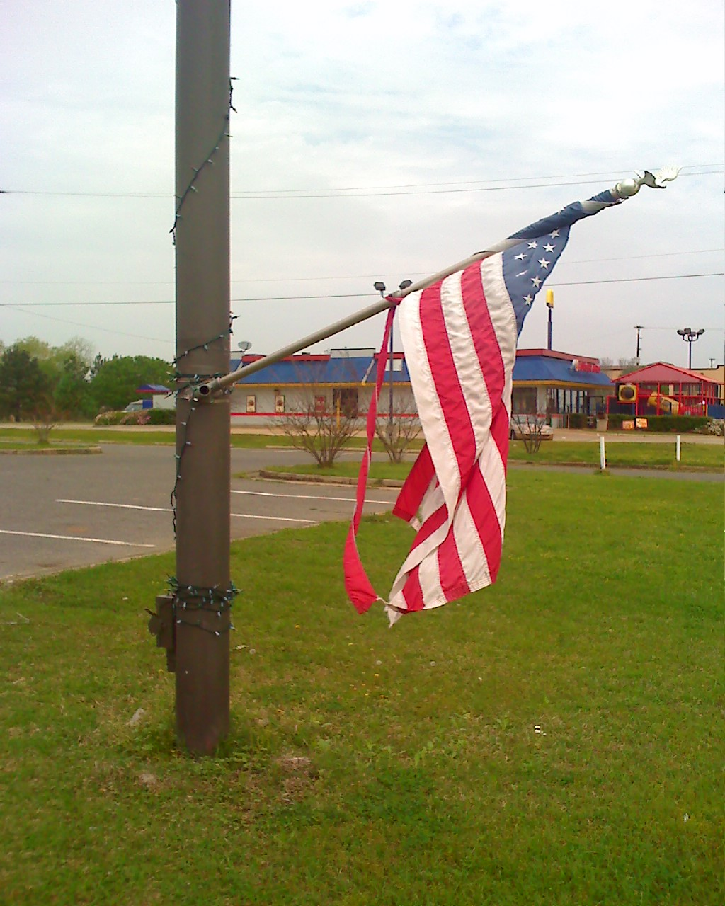 A Potential New Year's Resolution in behalf of our country and our troops-tattered-flag.jpg